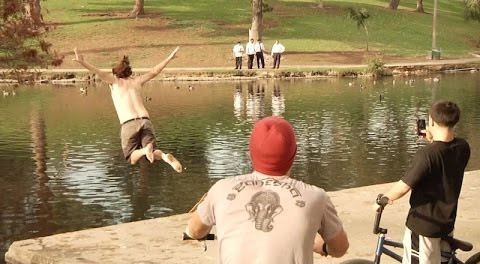 LOL – Drunk Guy Jumps In Disgusting Lake for 5 Dollars