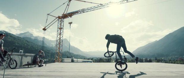 Riding BMX on Moun10 Youth Hostel Roof